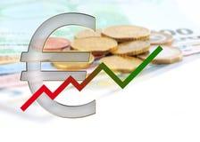 Diagramma verso l'alto con ed euro simbolo Fotografia Stock