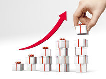 Diagramme à barres fait de giftboxes avec la bande rouge Photo libre de droits