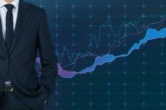 Diagramme d'homme d'affaires et d'actions Photographie stock libre de droits