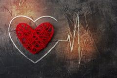 Diagramme de coeur pendant l'amour sur un fond foncé Le thème pour le jour du ` s de Valentine Photos libres de droits