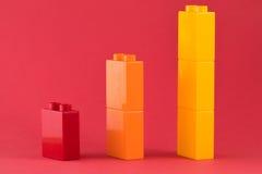Diagramme de Lego sur le fond rouge Images libres de droits
