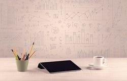 Diagrammes de graphique et bureau de concepteur Image libre de droits