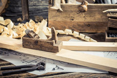 Diagrams and drafting tools in carpentry workshop Royalty Free Stock Photo
