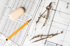 Diagrams and drawing tools on the table with a pencil and an era Stock Photo