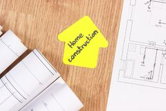 Electrical drawings or diagrams and house shape with text home conctruction, building home concept. Diagrams or electrical construction drawings and yellow paper stock photo