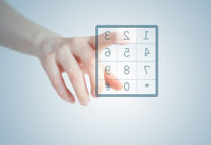 Dial. Ing a number. finger pushing button on screen Royalty Free Stock Photo
