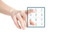 Dial. Ing a number. finger pushing button on screen Royalty Free Stock Photography