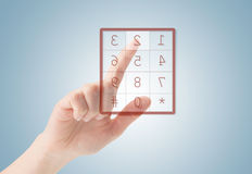 Dial. Ing a number. finger pushing button on screen Royalty Free Stock Image