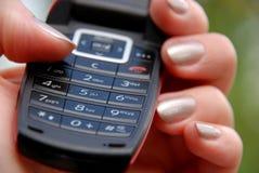 Dial. Female hand holding mobile phone keypad Stock Photo