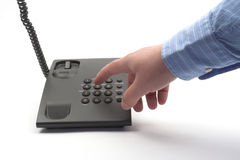 Dial. With a black office telephone over white stock image