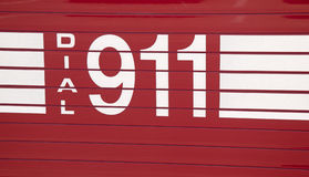 Dial 911 - decal. On side of a fire truck stock photography