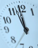 Dial of analog hours. A photo close up. Blue tone Stock Images