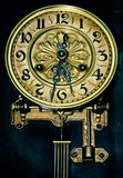 Dial of ancient hours. Of the forgotten things hanging in a dark closet royalty free stock photography