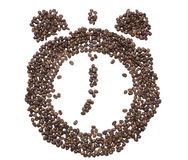 The dial of the clock with bells inlaid with roasted coffee bean Stock Photo