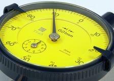 Dial gauge. Yellow dial gauge in a closeup Royalty Free Stock Photos