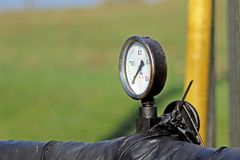 The dial of the gauge of measurement of pressure of a liquid. Oil pump station. Tansport and distribution of oil. Technology of oi. L transportation system Royalty Free Stock Image