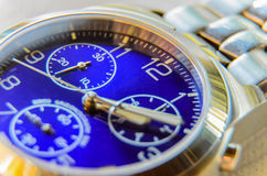 The dial and hands wristwatch. Picture close-up of wrist watches with blue dial Royalty Free Stock Photography