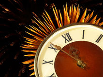 Dial of hours on a golden firework background.Eve of new year. Dial of hours on a golden firework in darkness background.Eve of new year Royalty Free Stock Photos