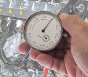 Dial indicator. Digital indicator in hand for precise measurement Stock Photography