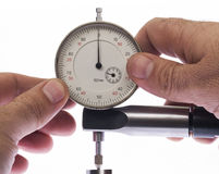 Dial indicator. Digital indicator in hand for precise measurement royalty free stock photos