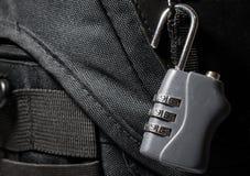 Dial lock. Padlock with dial on black bag Stock Image