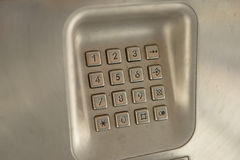 Dial number button on used public telephone Royalty Free Stock Photos
