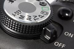 Dial and on/off button on DSLR camera Royalty Free Stock Photos