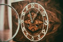 The dial of the old clock. Vintage wooden clock with the lid open Stock Image