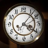 Dial of an old pendulum clock with beautiful figures. Low key Royalty Free Stock Images