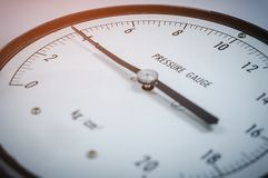 Dial pressure gauge. Pressure gauge 4 kilogram per square centimeter selective of focus Royalty Free Stock Photo