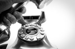 Dial the telephone. The retro telephone is ready for call in black and white Royalty Free Stock Image