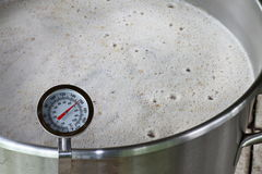 Dial Thermometer in Beer Mash Stock Images