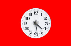 Dial watch on a red background. Old vintage clock face Stock Images