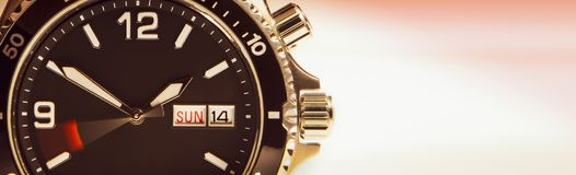 The dial of the wristwatch with a moving second hand symbolizing the run of time. royalty free stock photo