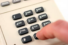 Dialing 0 on a touch tone phon Royalty Free Stock Photos