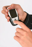 Dialing on a cellular phone. Finger dialing on a cellular phone Royalty Free Stock Photo