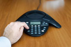 Dialing on conference phone Stock Image