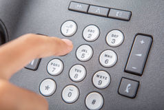 Dialing Desktop Telephone III Stock Photography