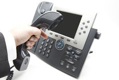 Dialing IP telephone keypad. Making a call, Businessman is dialing IP telephone keypad Royalty Free Stock Images