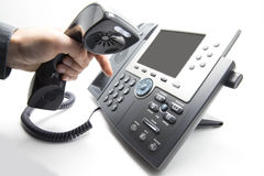 Dialing IP telephone keypad. Making a call, man is dialing IP telephone keypad Stock Photo