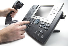 Dialing IP telephone keypad. Making a call, man is dialing IP telephone keypad Royalty Free Stock Images