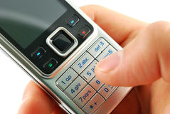 Dialing a mobile phone closeup Royalty Free Stock Photos