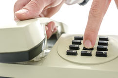 Dialing a number on an old telephone Royalty Free Stock Photo