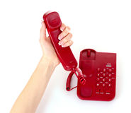 Dialing on the red phone Royalty Free Stock Image