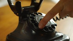 Dialing with an retro rotary phone - Includes audio dial phone stock video footage