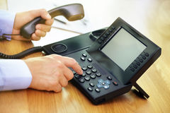 Dialing telephone keypad. Concept for communication, contact us and customer service support royalty free stock photo