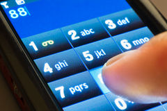 Dialing on touchscreen smartphone Royalty Free Stock Photography