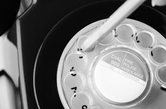 Dialling a Number on Retro Telephone in Black and White Stock Photography