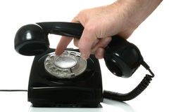 Dialling out on a telephone Stock Photos