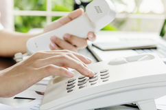 Dialling on a telephone Stock Photo
